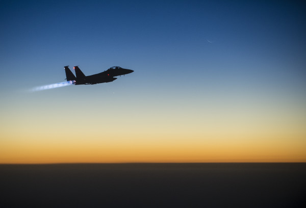 A U.S. Air Force F-15E Strike Eagle flies over northern Iraq early in the morning of Sept. 23, 2014, after conducting airstrikes in Syria. This F-15 was a part of a large coalition strike package that was the first to strike ISIL targets in Syria. (U.S. Air Force photo by Senior Airman Matthew Bruch/Released)